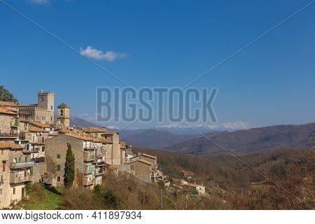 View Of The Old Town Of Orvinio With The Snow-capped Mountains In The Background. Province Of Rieti,