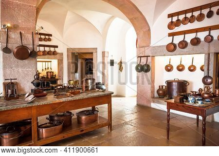 Kitchen With Old Cooper Utensils, Retro Furniture In Vintage Style Rural Home. Traditional Cottage P