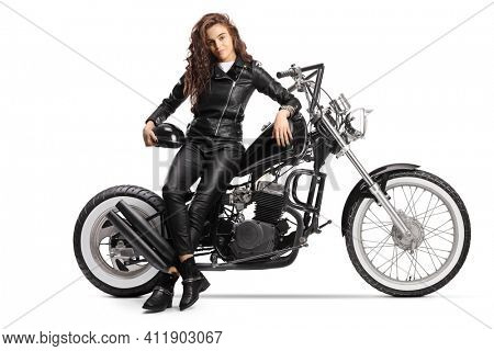 Young woman with a long curly hair sitting on a custom chopper motorbike isolated on white background