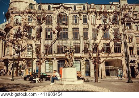 Porto, Portugal: People Relaxing In Old City With Busy Streets And Historical Monuments On 20 May, 2