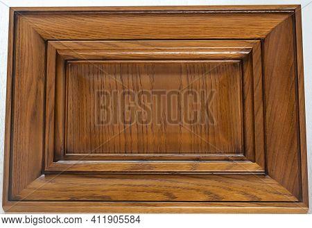 Lacquered Textured Brown Rectangular Kitchen Facade Close-up. Wood Textured Decorative Element Backg