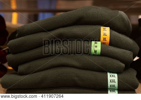 Knitwear, A Stack Of Green Sweaters, Clothing