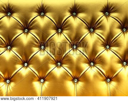Stylish Gold Soft Leather Upholstery Of Sofa. The Material Is Decorated With Buttons In The Form Of