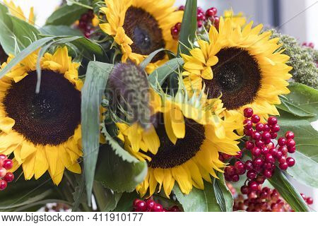 A Bouquet Of Autumn Sunflowers And Red Viburnum On The Background Of A White Wall. Horizontal Frame