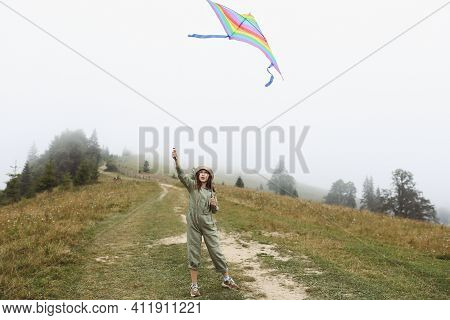 Little Cute 7 Years Old Girl Playing With Colorful Kite On Foggy Day In The Mountains. Happy Child I