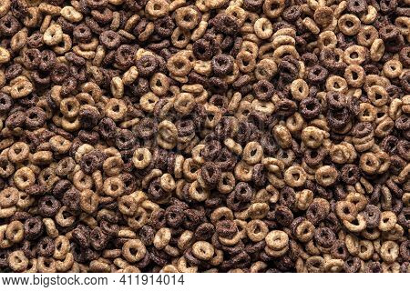 Delicious Peanut Butter And Chocolate Cereals In A Ring Shape, Full-frame. Background Of Nutrition B
