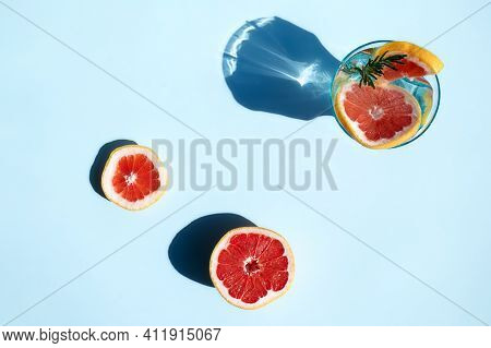 Summer Cocktail With Grapefruit, Rosemary And Slices Citrus Fruits.fresh Healthy Grapefruit Beverage