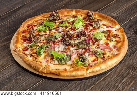Fresh Pizza With Tomato Sauce, Black Olives, Mozzarella Cheese, Ham On Wooden Table Closeup. Space F