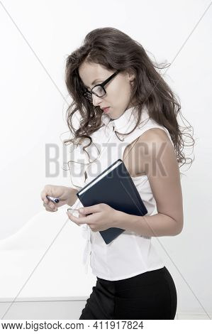 Secretary Concentrated On Making Notes. Smart Looking Lady In Office. Woman Boss In Sexy Glasses. Su