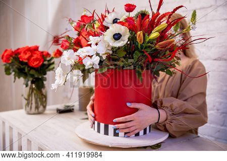 A Flower Arrangement In Red Shades Of Orchids, Roses, Sunflowers, Lilies, Alstroemerias And Ornithog