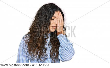 Young hispanic girl wearing casual clothes yawning tired covering half face, eye and mouth with hand. face hurts in pain.