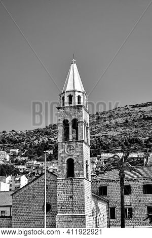 Tower Of Medieval Church In The Town Of Dubrownik In Croatia, Monochrome