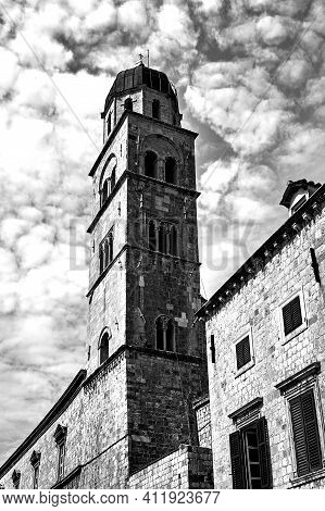 Street With Medieval Buildings And Stone Belfry Of The City Of Dubrovnik In Croatia, Monochrome