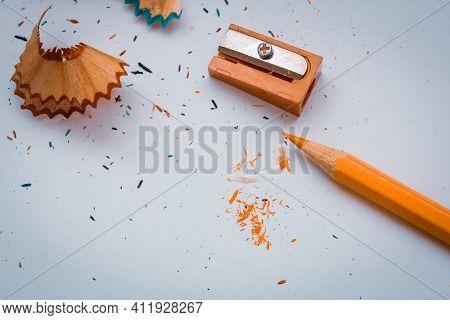 Opened Orange Pencil With Orange Pencil Sharpener. Orange Pencil Chips. Orange Pencil On A White Bac