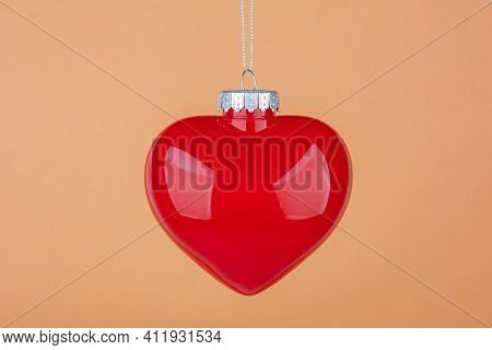 Decorative Heart Isolated On Orange Background. Shot In Studio.