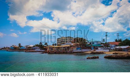 Grand Cayman, Cayman Islands, July 2020, View Of Some Buildings With Restaurants And Stores By The C