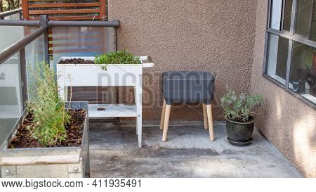 A Vermicomposting System (worm Composter) Sits On An Apartment Balcony With Other Patio Planters. Wo