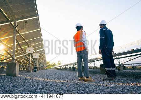 Engineers With Investor Walk To Check The Operation Of The Solar Farm(solar Panel) Systems, Alternat