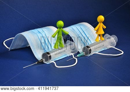 Preventive Vaccination, Disposable Syringes And Antibacterial Face Masks.