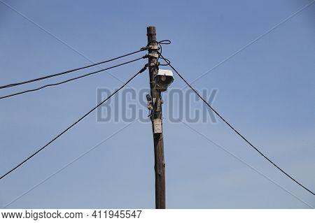 Single Street Light With Electricity Cables Leading Off