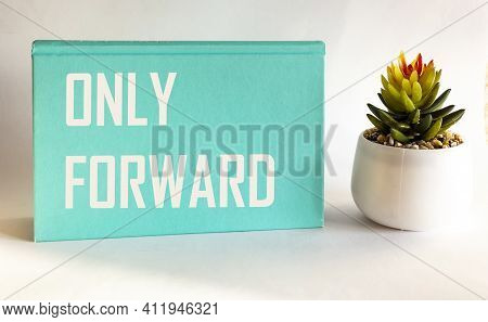 Only Forward .motivational Quote Written On Green Notepad And White Background. Positive Vibes Only