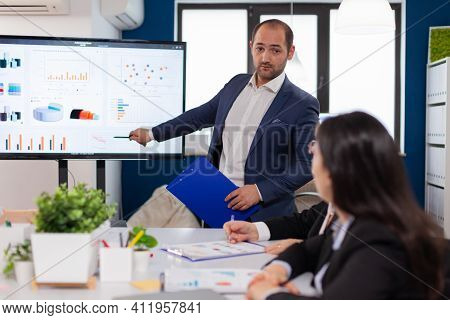 Successful Team Leader Briefing Pointing Explaining Project In Conference Room Brainstorming. Corpor