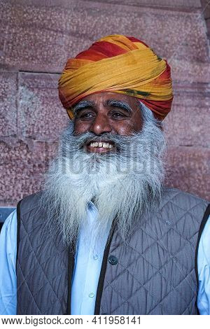 Jodhpur, India - Jan 02, 2020: Portrait Of Aged Rajasthani Man In Traditional Dress And Colorful Tur