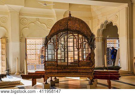 Jodhpur, India - Jan 02, 2020: Ancient Royal Gold Palanquin Mode Of Transportation On Display At The