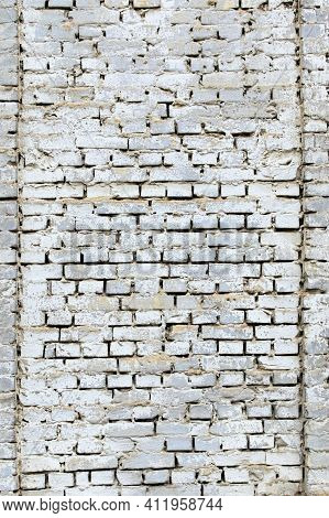 Background Of White Brick Wall Texture. Close-up View Of Cement Bonded Brick Wall. An Ancient White