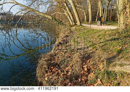 Lyon, France, March 10, 2021 : Running Or Biking Are Usual Activities All Around The Alleys, All Yea