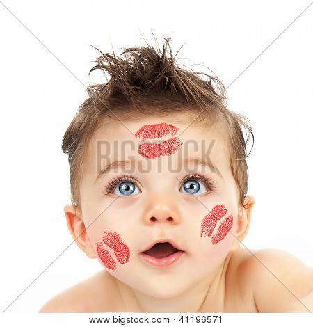 Picture of small cute Cupid, closeup portrait of pretty child with red kisses on his cheeks isolated on white background, curious little boy with beautiful blue eyes looking in camera, Valentine day