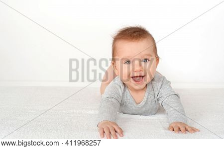 Portrait Of A Cute Baby Boy With Blue Eyes On White Background