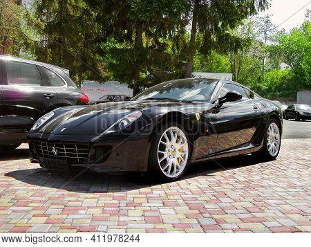 Kiev, Ukraine - May 14, 2011: Black Supercar Ferrari 599 Fiorano In The City