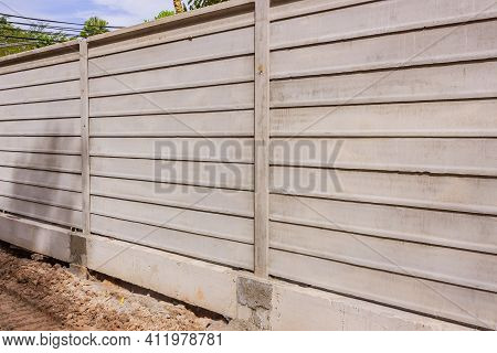 The Unfinished Boundary Fence By The Precast Concrete Wall.