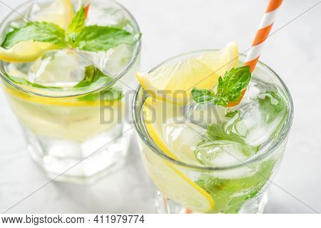 Cold Refreshing Lemonade Or Mojito With Ice And Mint Leaves.