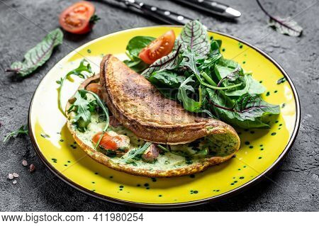 Omelette With Cheese, Tomatoes Frittata Italian Omelet On A Yellow Plate On A Gray Background. Keto,