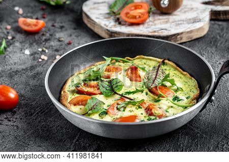 Classic Italian Frittata With Tomatoes, Cheese And Herbs In The Pan. Keto, Ketogenic Lunch. Food Rec