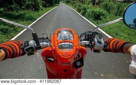 Scooter Road Trip. Pov View, First Person. Men On Red Motorbike In White Clothes On Drive Forest Roa