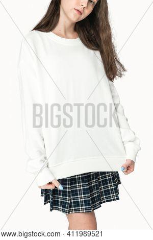 Teenage girl in white sweater apparel studio portrait