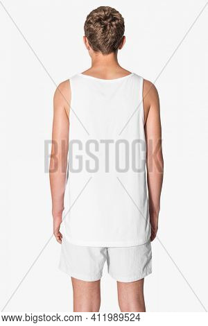 Men's white tank top and gray shorts for teen's summer apparel shoot with design space