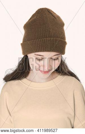 Teenage girl in color beanie for teenage apparel shoot