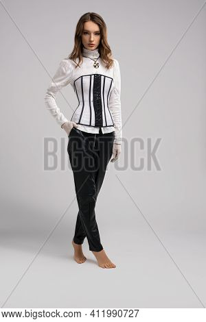 Female Model In Elegant Clothes With Corset