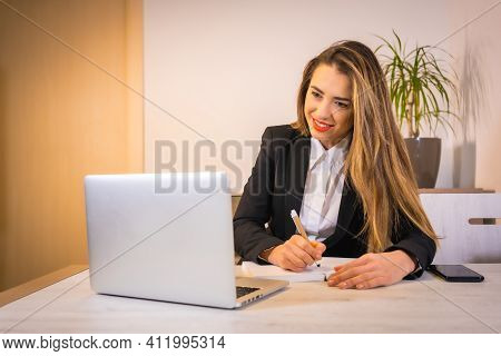 Teleworking At Home During The Coronavirus Pandemic, Young Blonde Caucasian Woman With A Coffee Work