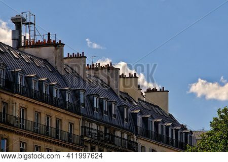 Beautiful Residential Buildings With Balconys And Chimneys At The Rooftops In Sunny Paris France