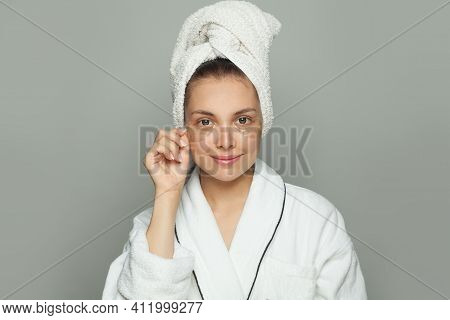 Attractive Spa Woman In Hydrogel Eye Patches On Her Skin. Facial Treatment And Skin Care Concept