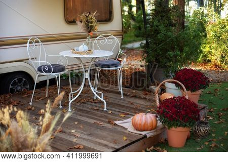 Cozy Wooden House Porch With Garden Furniture. Decor Summer Yard. Interior Cozy Patio With Chrysanth
