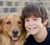 Cute Little Boy Smiling With His Dog poster