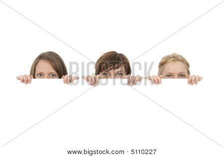 Three Young Women Behind A Blank Banner Ad