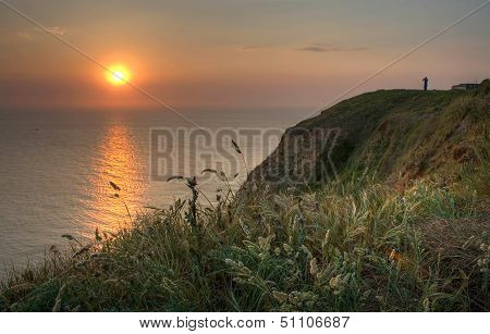 Normandy Sunset Landscape With Herbal On The Coast