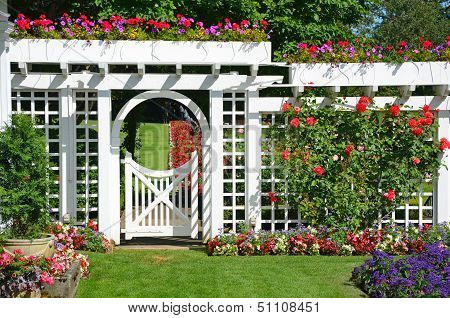 White Garden Gate With Flowers